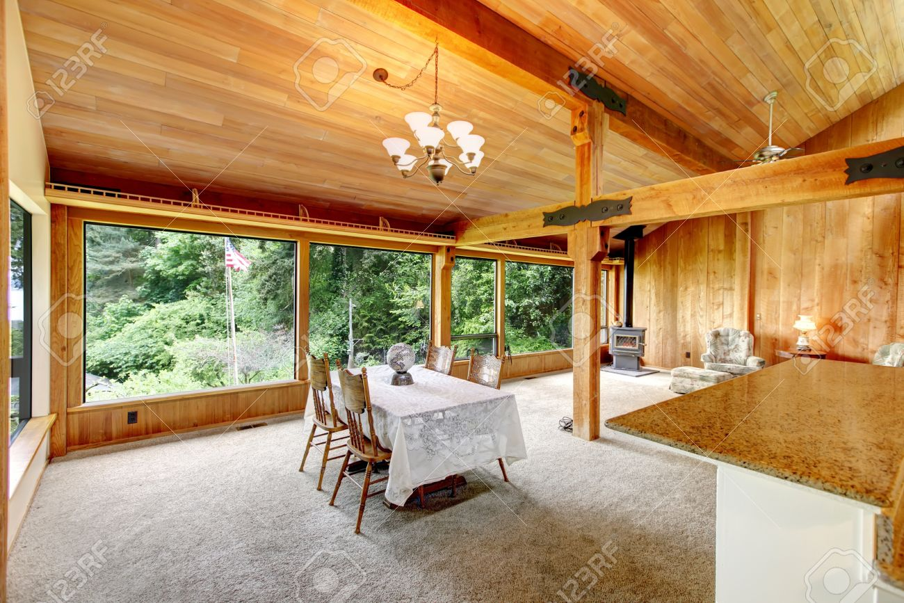 open floor plan in log cabin house. view of living room with