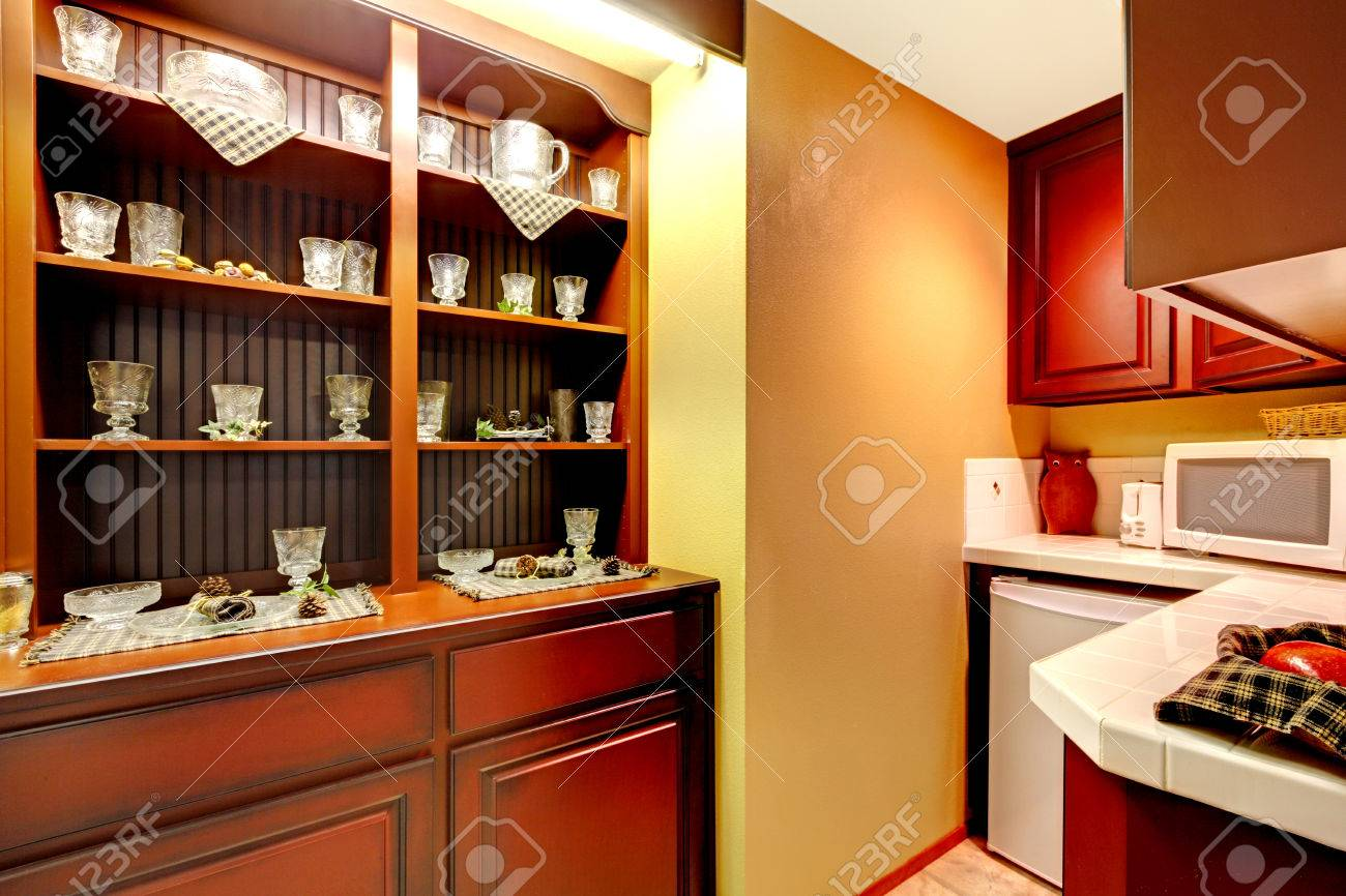 Burgundy Kitchen Cabinets With White Appliances And Old Storage