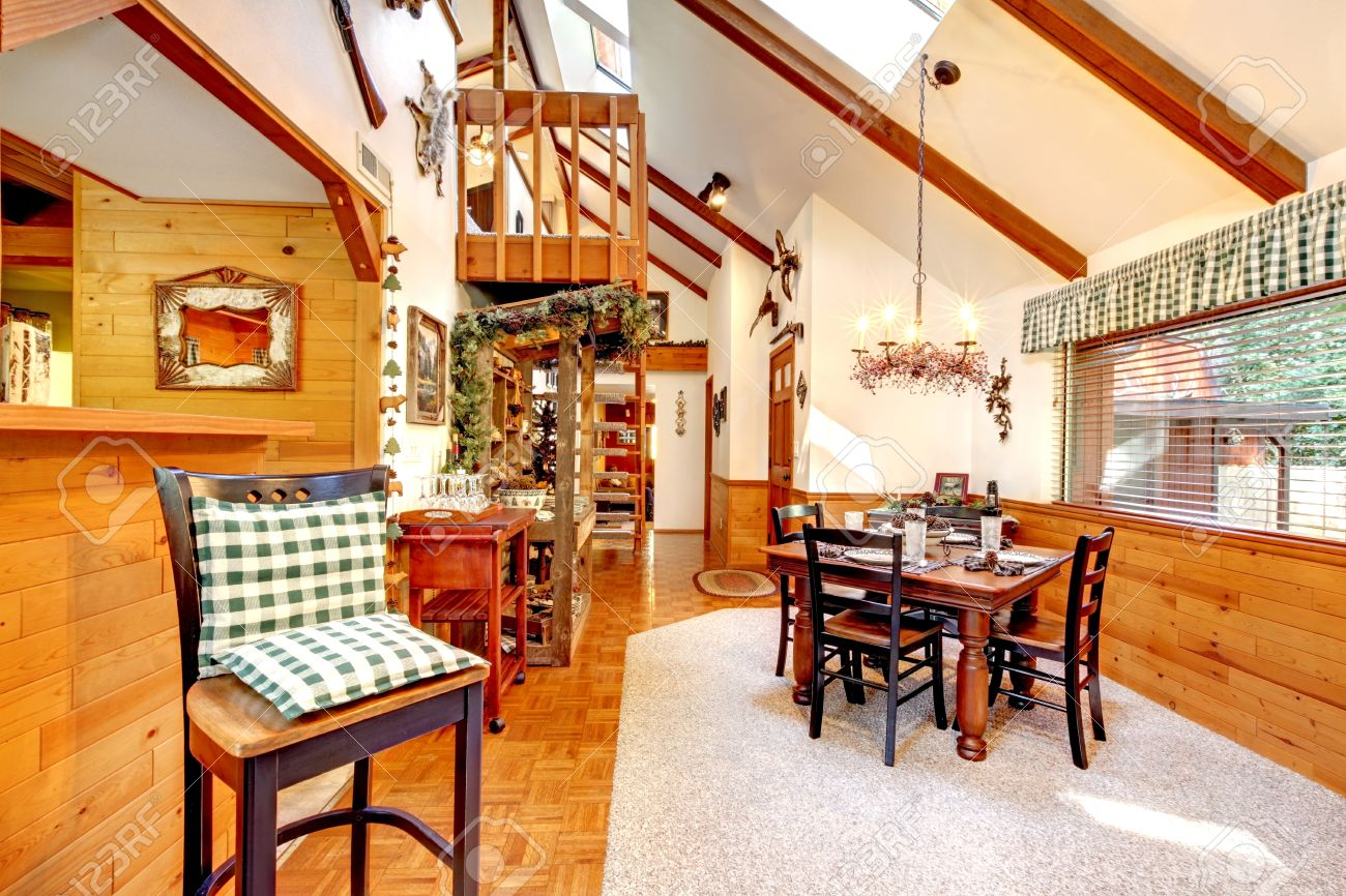 Bright Kitchen And Dining Room In Log Cabin House High Vaulted Ceiling With Beams Wooden