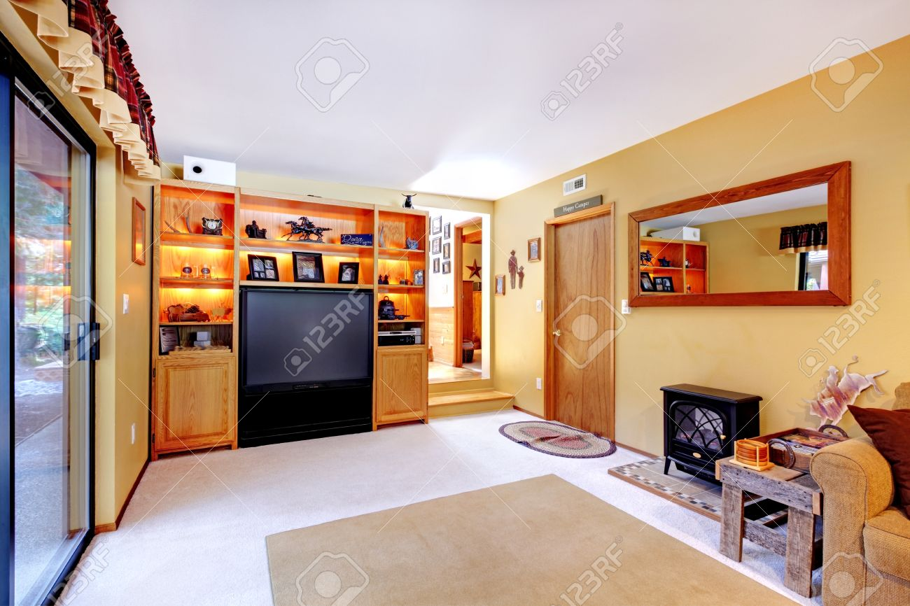 Small living room if soft colors View of cabinets with tv and..
