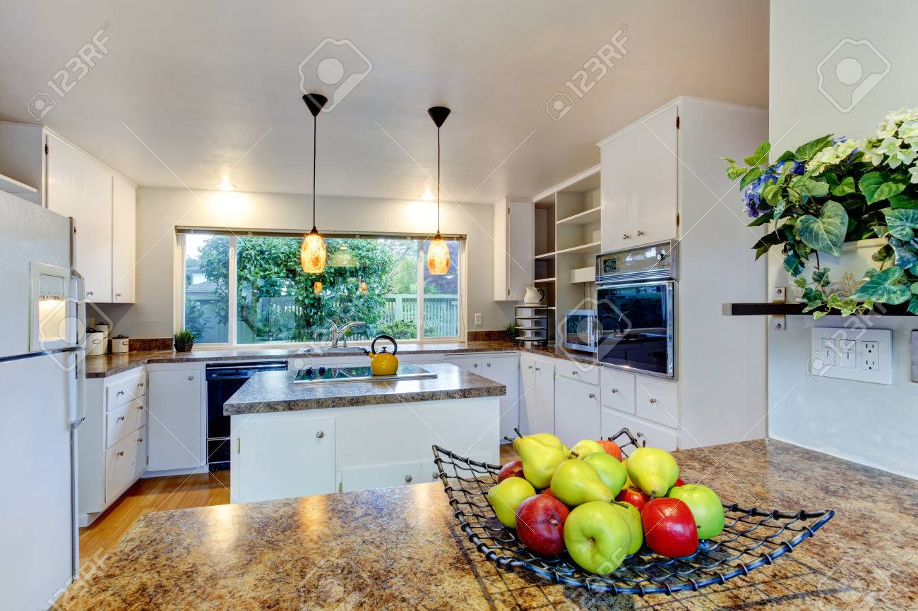 Kitchen Room With White Appliances, Kitchen Island And Wide Window ...