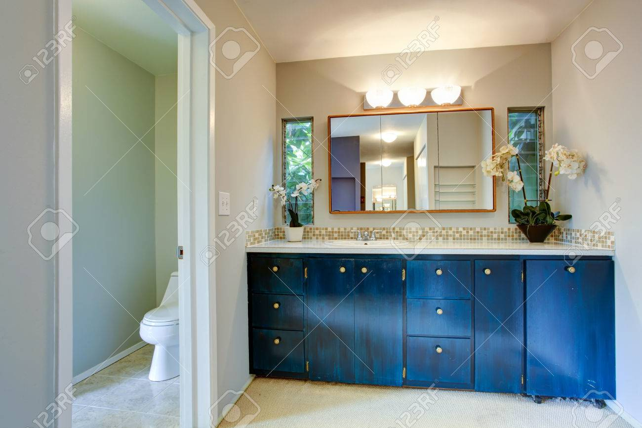 View Of Light Tones Bathroom With Wooden Blue Vanity Cabinet Stock Photo Picture And Royalty Free Image Image 29422647