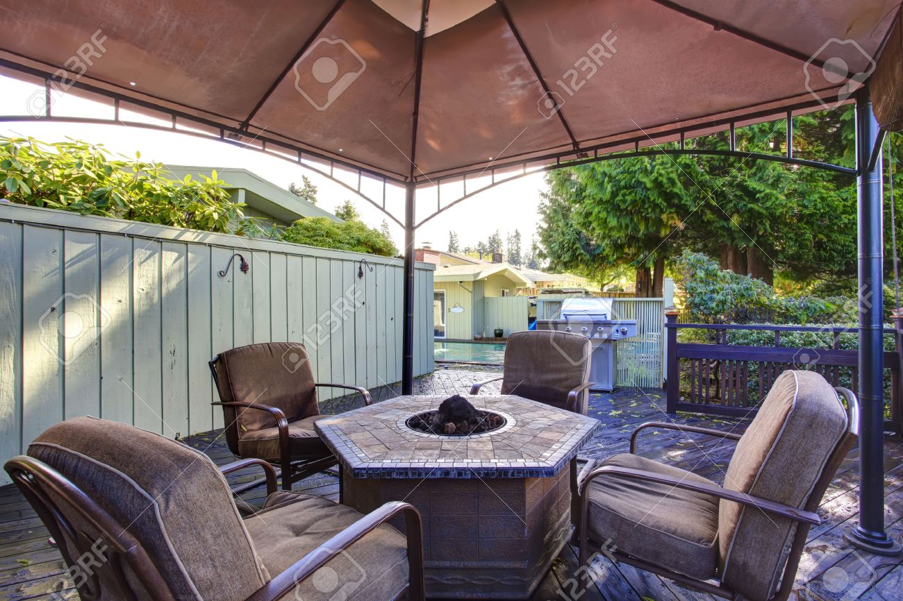 Wooden Deck With Railings And Gazebo Fire Pit Chairs Stock Photo