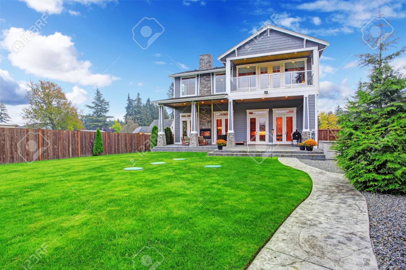 luxury house with backyard walkout deck and column porch view