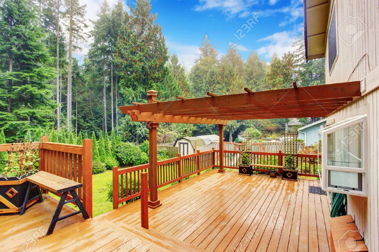 Spacious wooden deck with benches and attached pergola Stock Photo -  29735098 - Spacious Wooden Deck With Benches And Attached Pergola