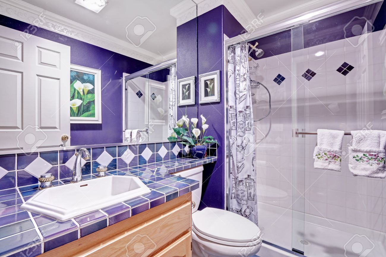 Bright Purple Bathroom With Tile Wall Trim And Glass Door Shower ...