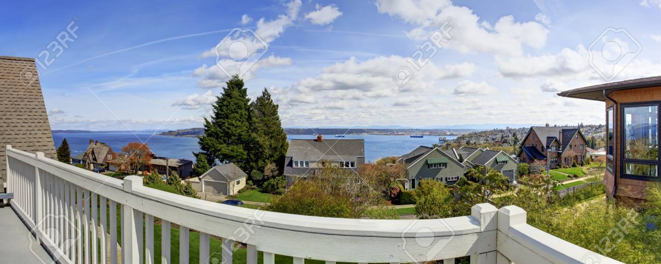 White walkout deck with railings overlooking neighborhood and lake. Panoramic view Stock Photo - 29938661