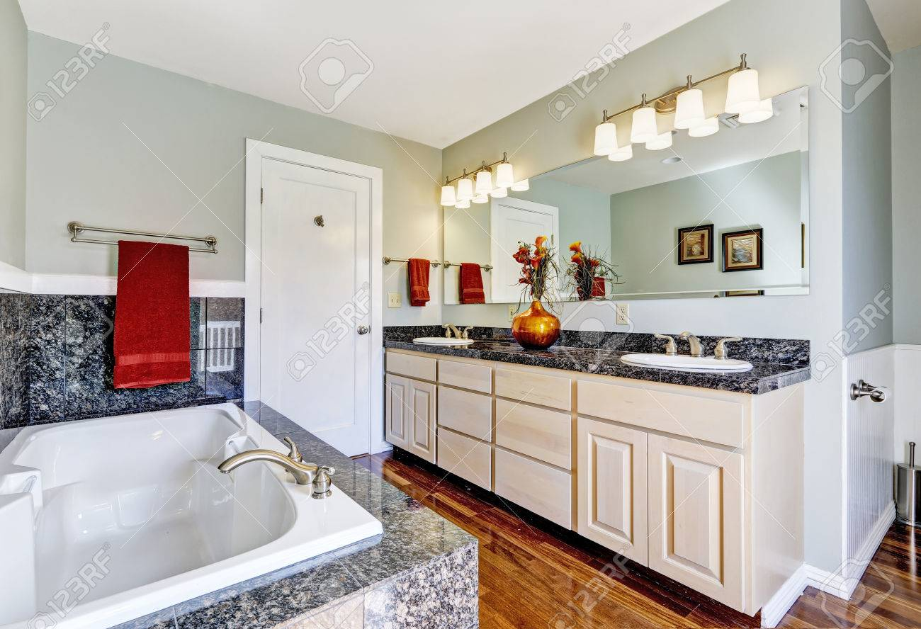 Modern Bathroom Interior With Granite Tile Trim, Hardwood Floor ...