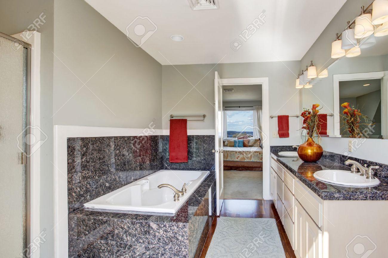 Modern Bathroom Interior With Granite Tile Trim, Hardwood Floor And ...