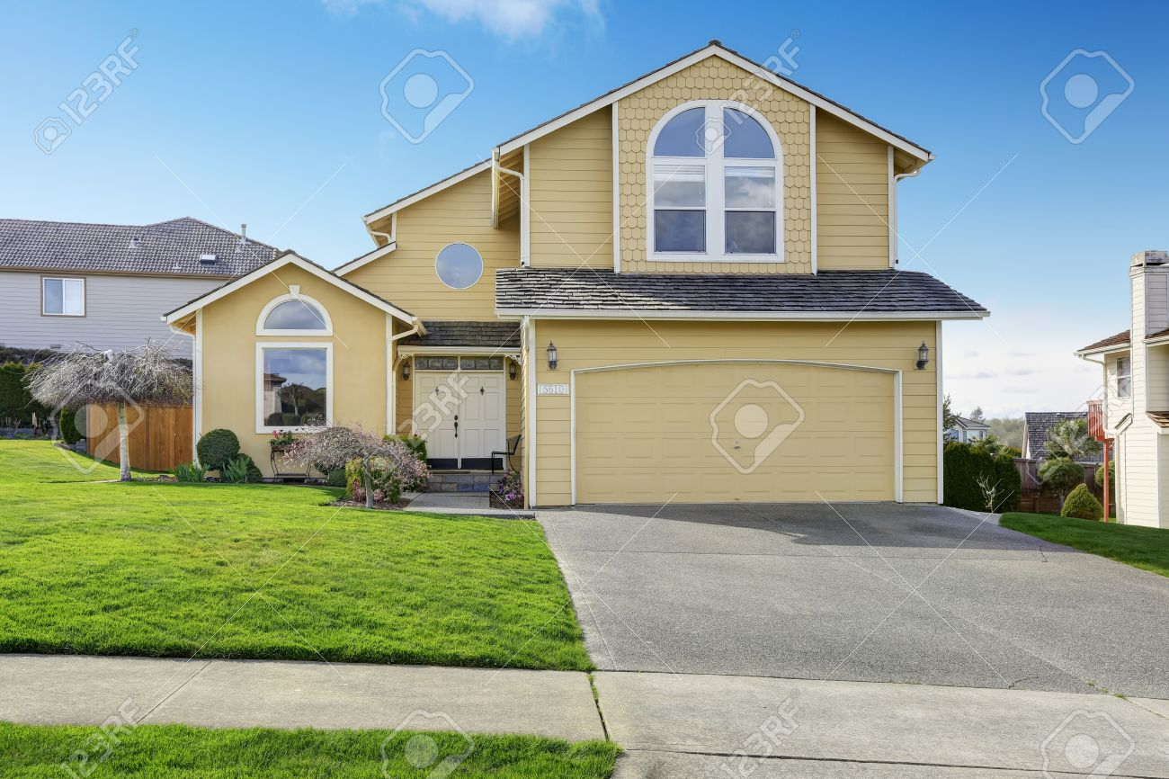 Big Ivory House With Garage View Of Front Yard And Driveway Stock Photo Picture And Royalty Free Image Image 30007624