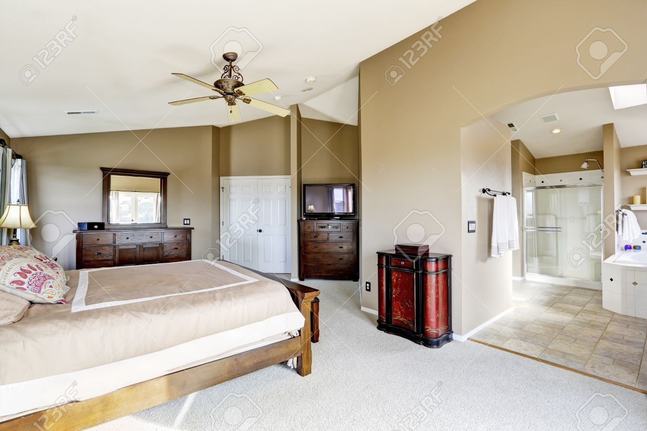 Master Bedroom Vanity luxury bright master bedroom interior with bathroom. view of