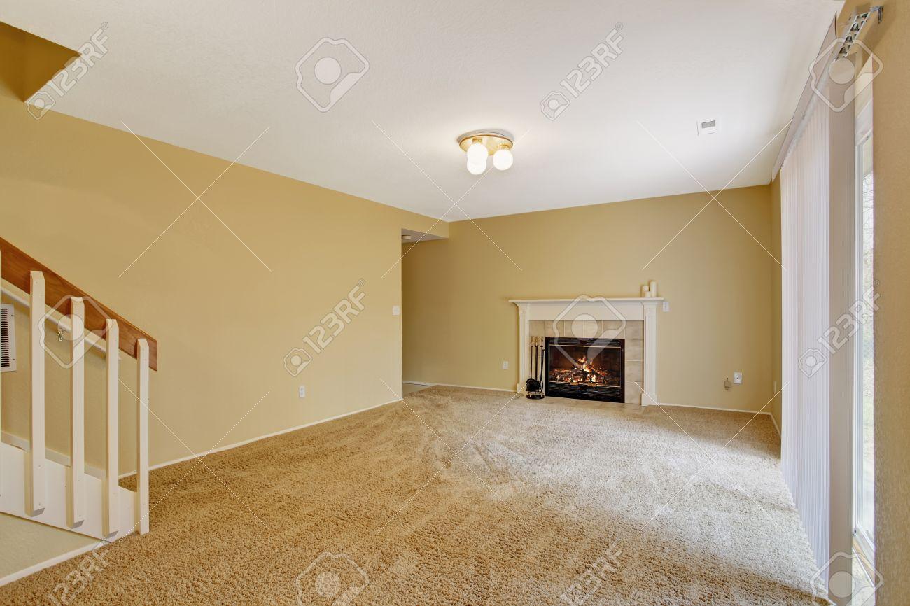 Empty living room with carpet - Empty House Interior View Of Empty Living Room With Fireplace And Soft Carpet Floor Stock