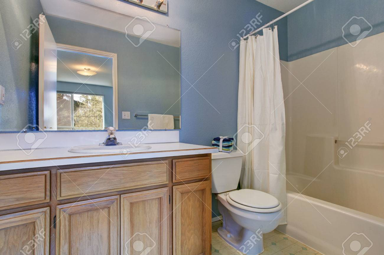 Light Blue Simple Bathroom Interior With Wooden Bathroom Vanity Stock Photo Picture And Royalty Free Image Image 30050708