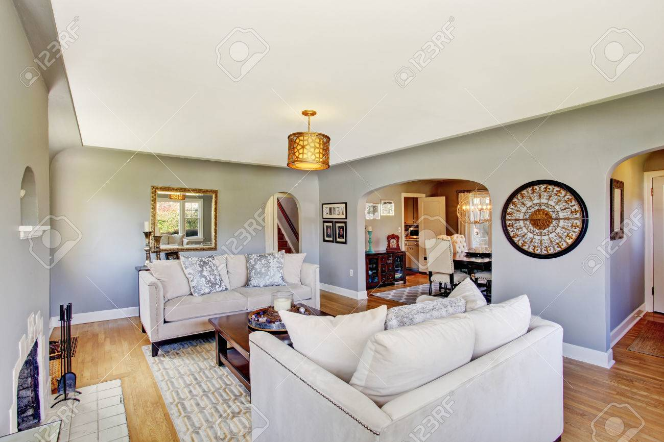 Light Grey Living Rom With Hardwood Floor And Rug Furnished White Sofas Wooden