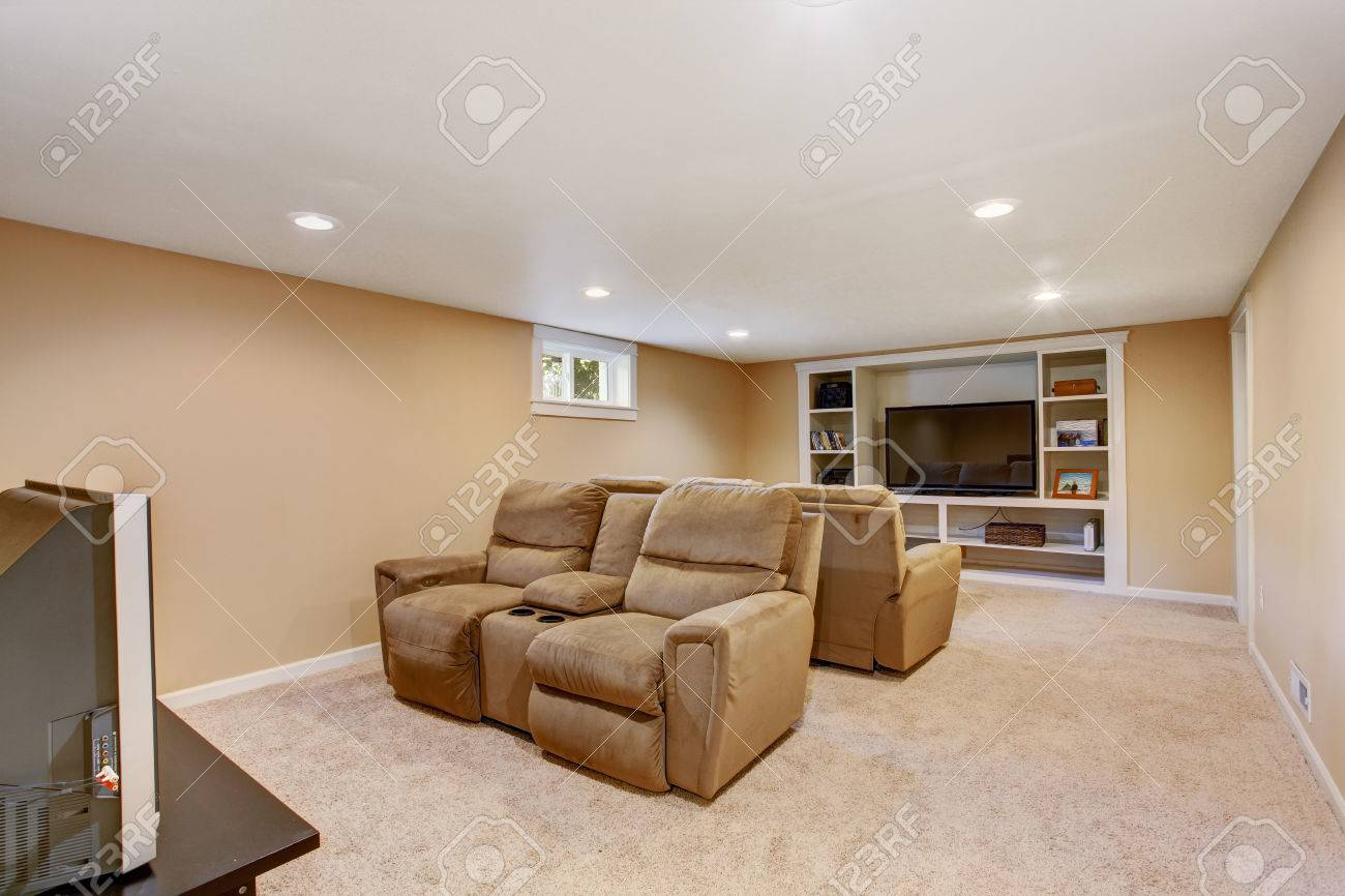 Comfortable arm chairs - Cozy Home Theater In Soft Brown Color With Comfortable Armchairs Stock Photo 30051373
