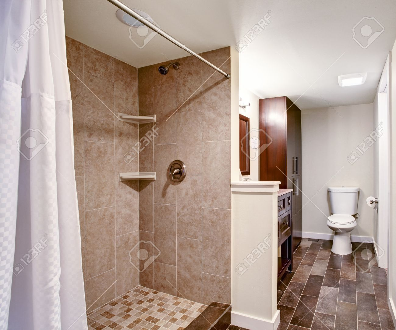 White Bathroom With Mocha Tile Wall Trim And Tile Floor. View ...