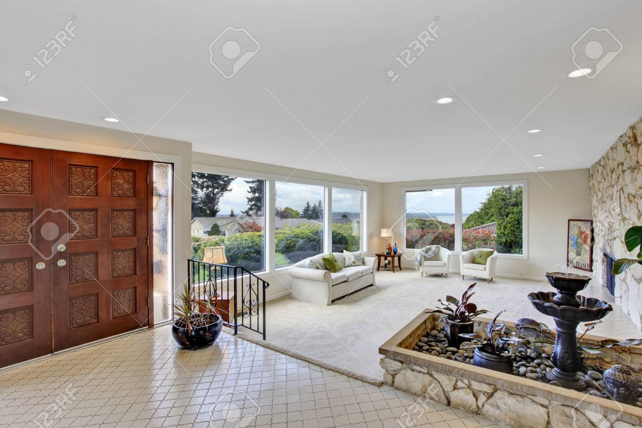 Bright Living Room With Fountain In Luxury House View Of Entrance Hall Tile Floor