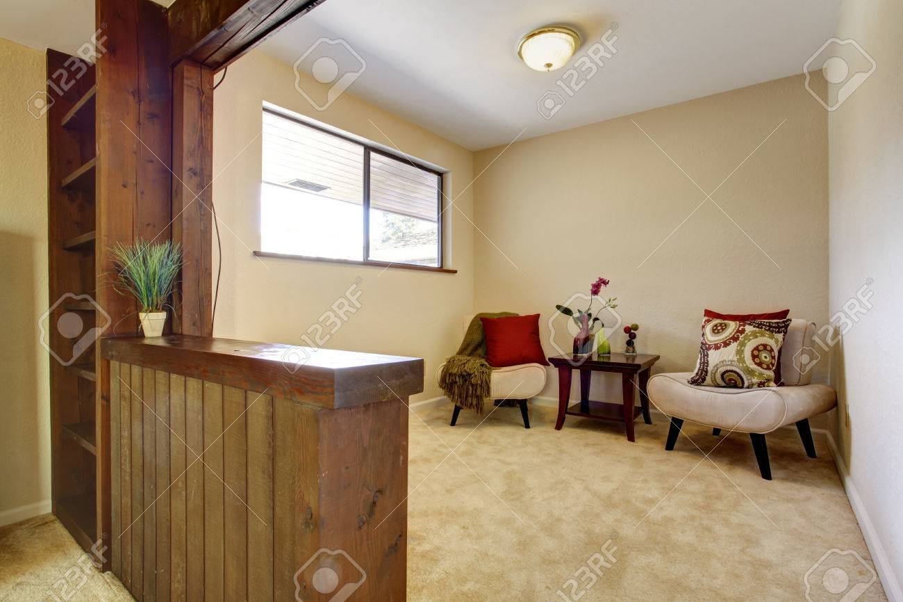 Small bedroom sitting area - Soft Ivory Bedroom Interior With Sitting Area Furnished With Wooden Small Table And Two Chairs Stock