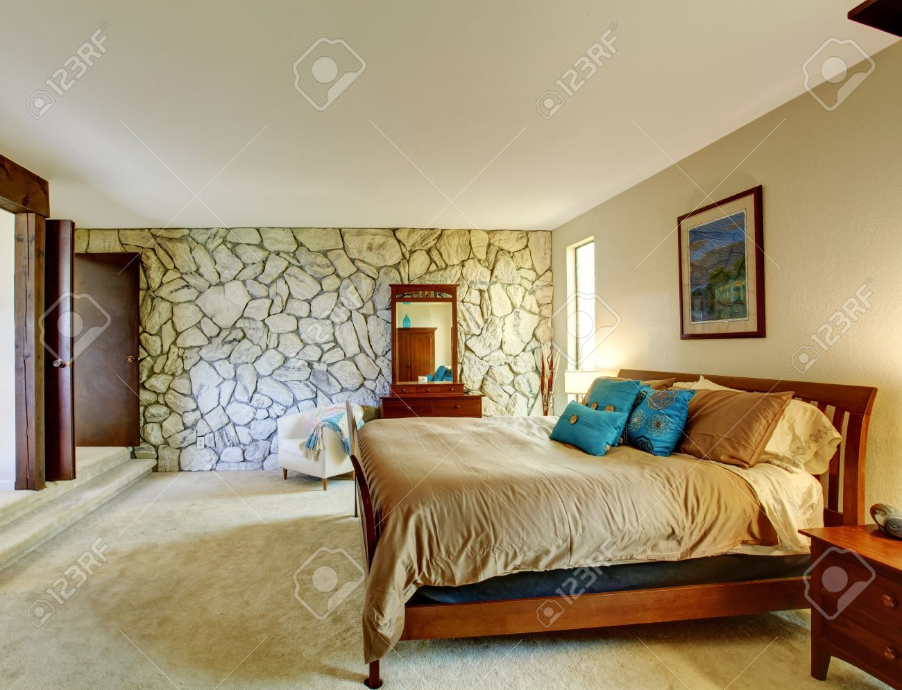 soft ivory bedroom interior with rock wall furnished with brown soft ivory bedroom interior with rock wall furnished with brown wooden furniture set stock photo