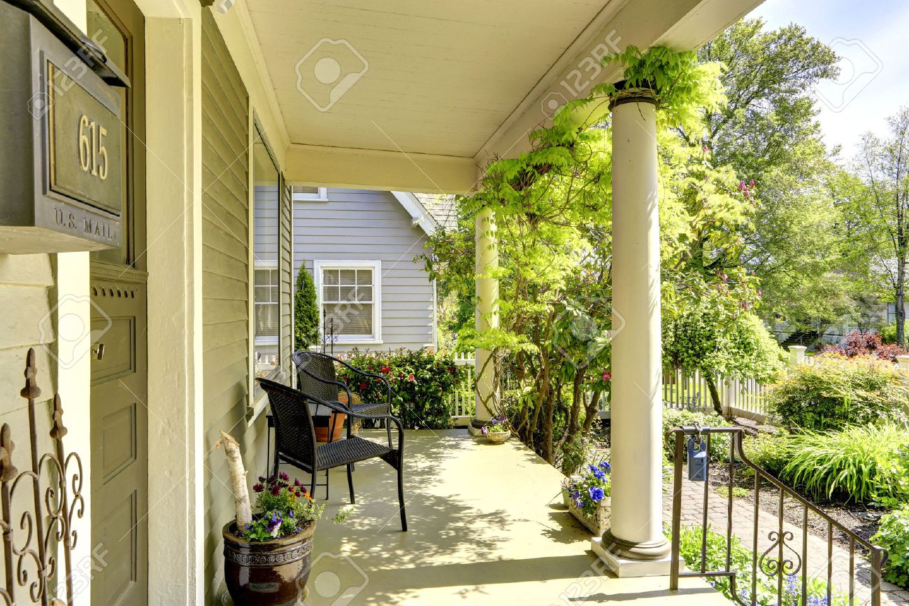 House Exterior. View Of Front Yard And Entrance Column Porch ...