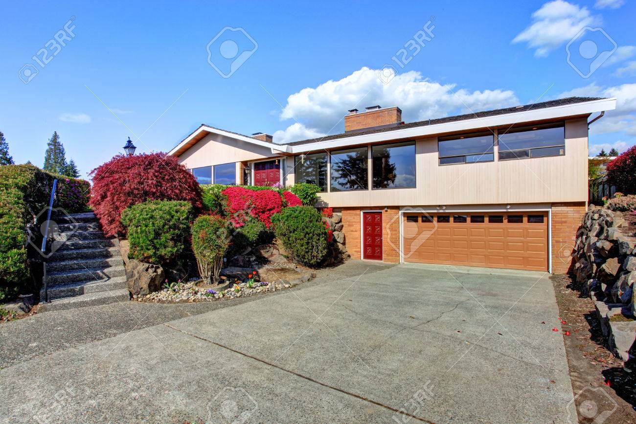 Modern house exterior with curb appeal view of garage and driveway stock photo 30057796