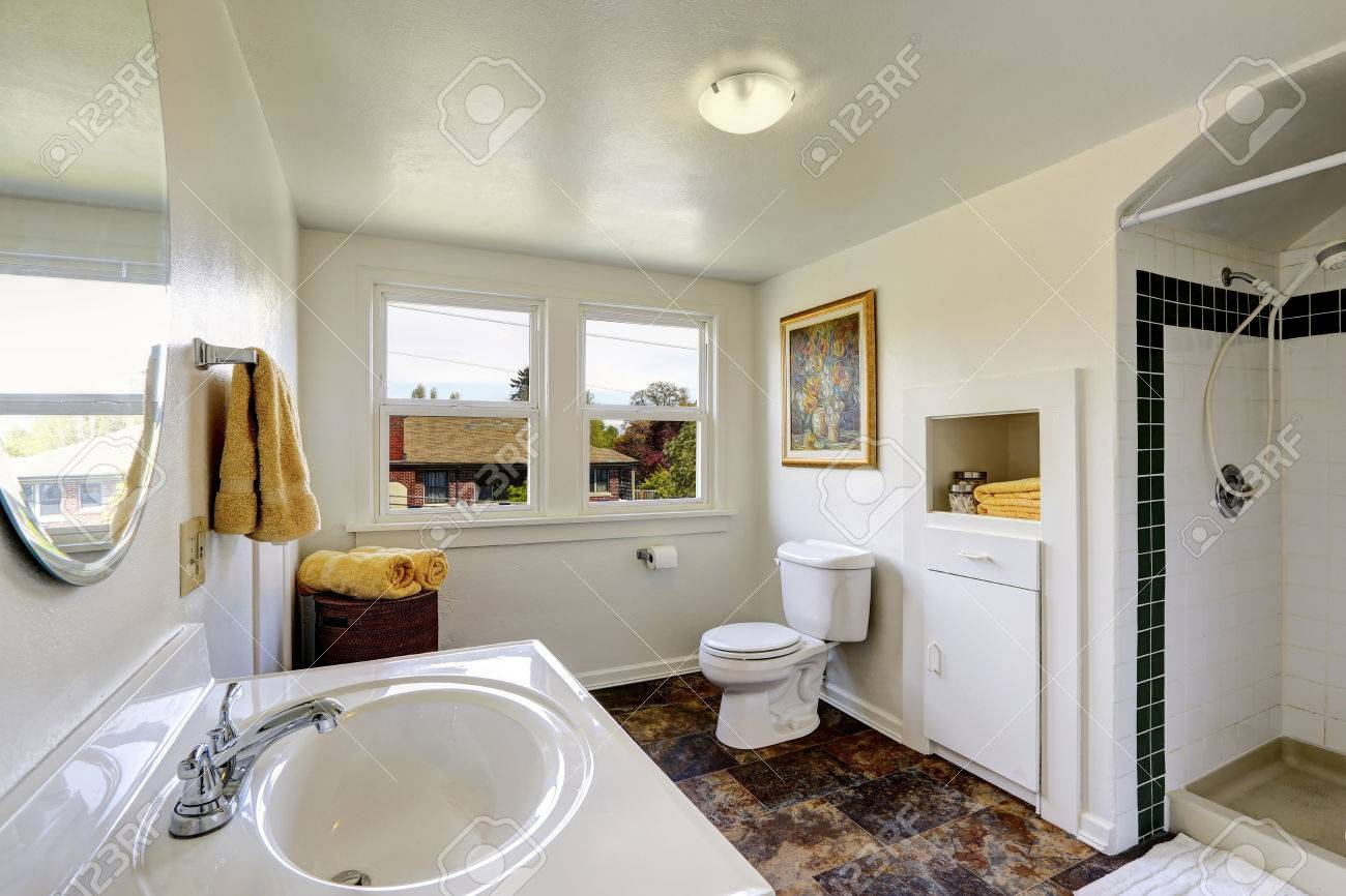 Brown Tiles Bathroom Bright Bathroom In White Color With Contrast Brown Tile Floor
