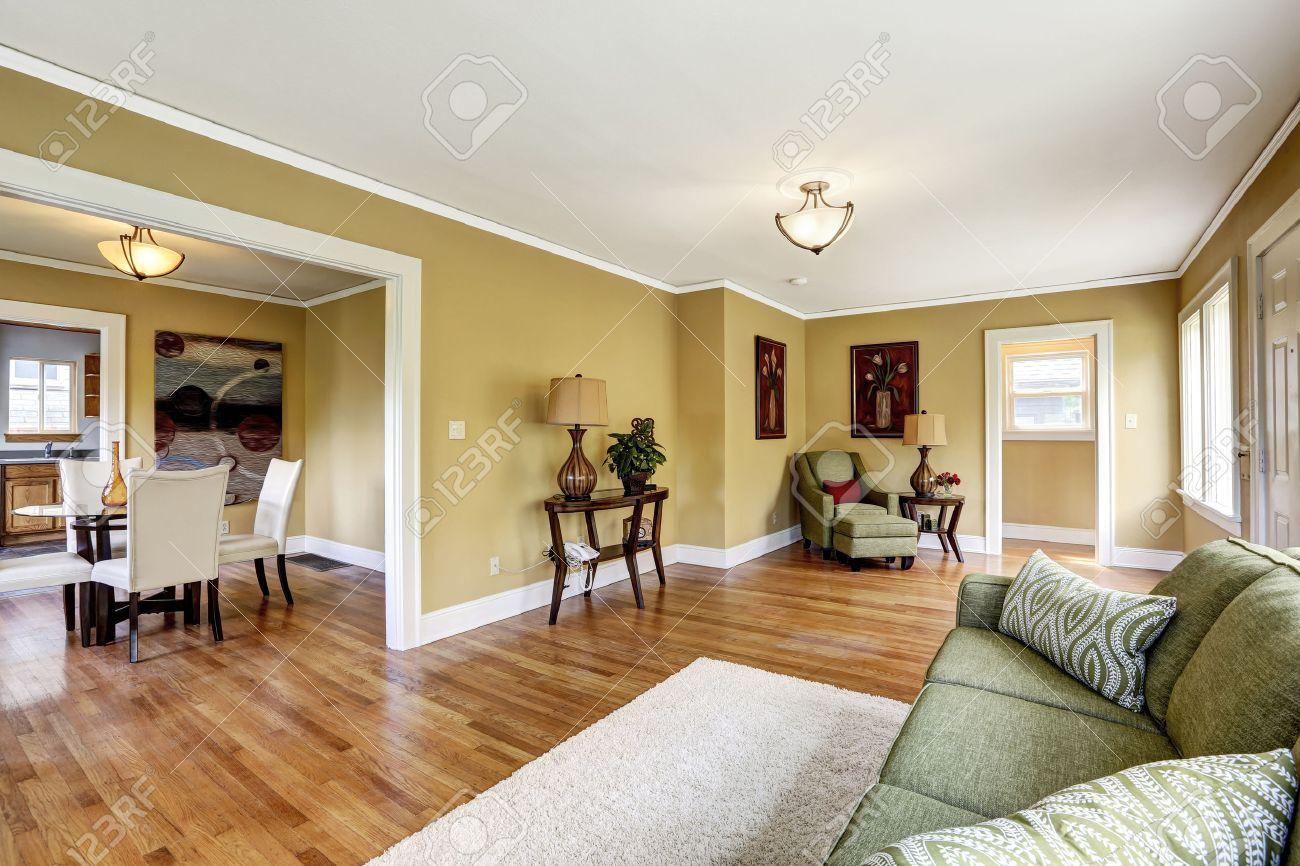 house interior with open floor plan room furnished with green house interior with open floor plan room furnished with green sofa and armchair view