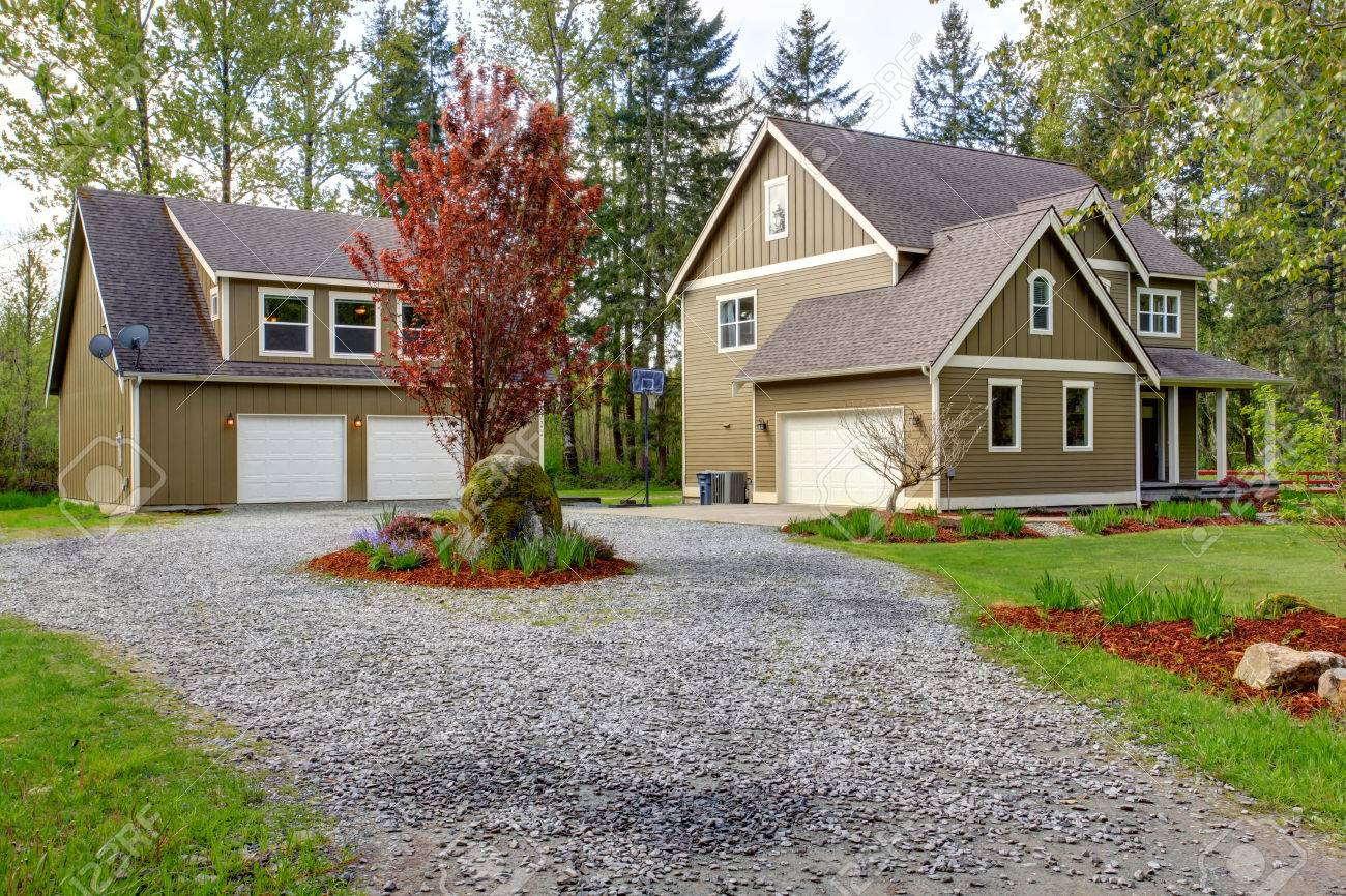 High Quality Countryside House Exterior With Garage. View Of Entrance And Gravel Driveway  Stock Photo   30130428