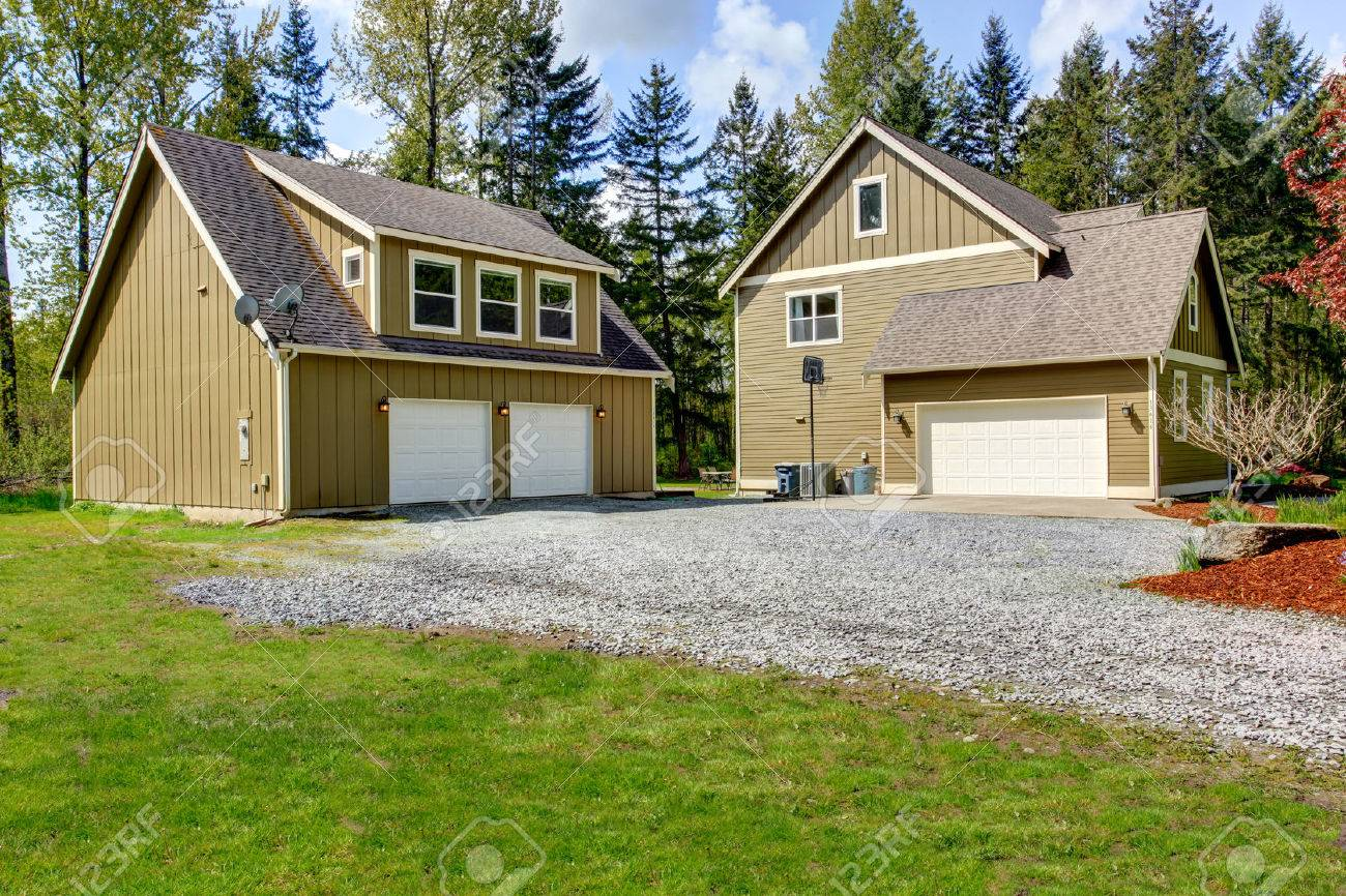 Countryside House Exterior With Garage. View Of Entrance And Gravel Driveway  Stock Photo   30130433
