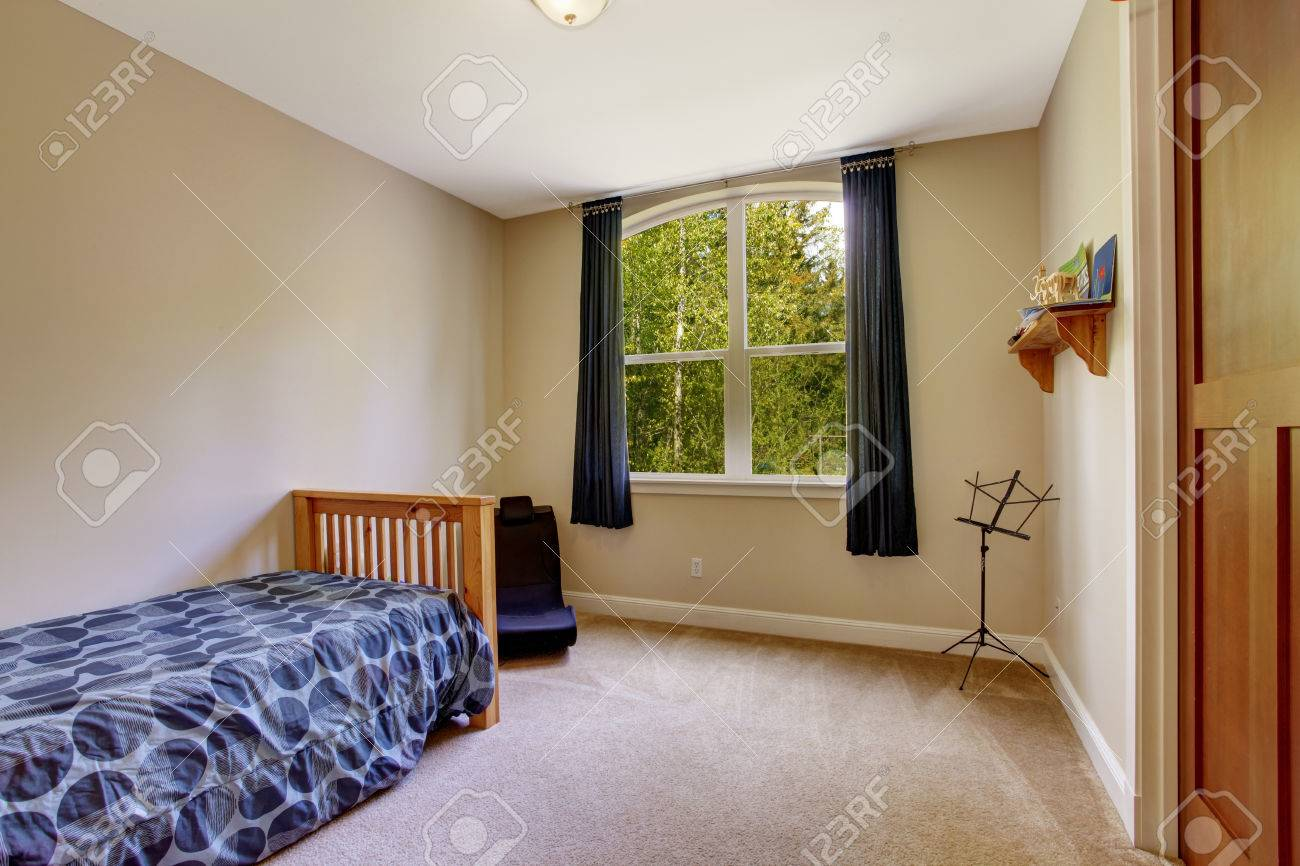 Small bedroom interior with window and one single bed