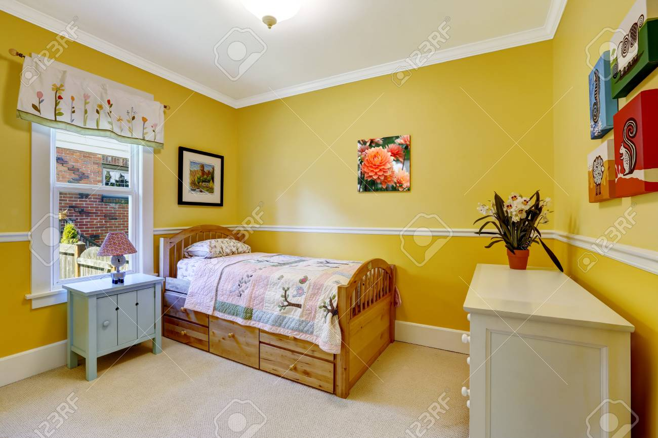 Happy Kids Room In Bright Yellow With Wooden Single Bed And Dresser Stock  Photo   30200845