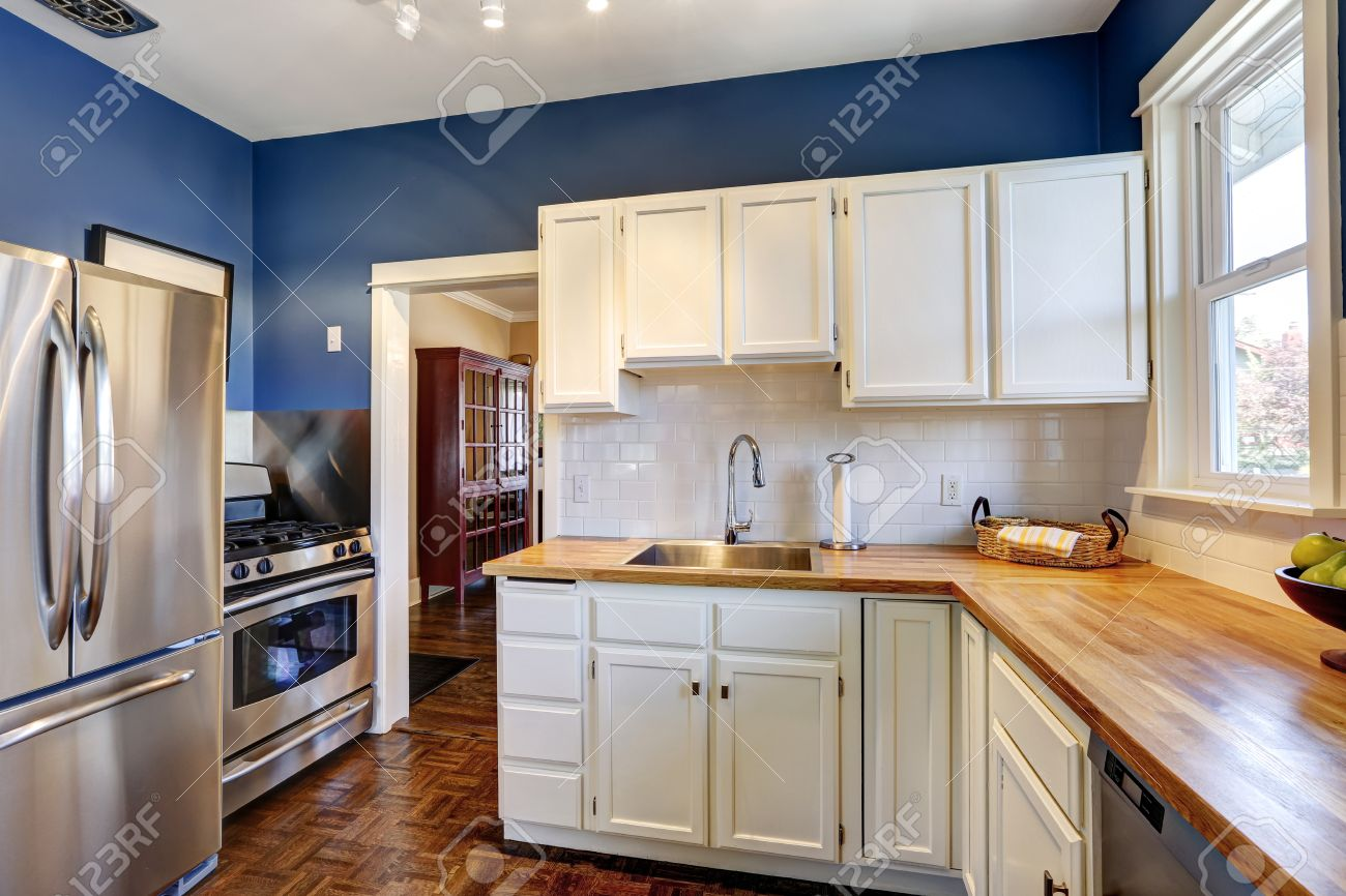 Kitchen Interior With White Cabinets And Bright Navy Walls Stock Photo Picture Royalty Free Image 30200759