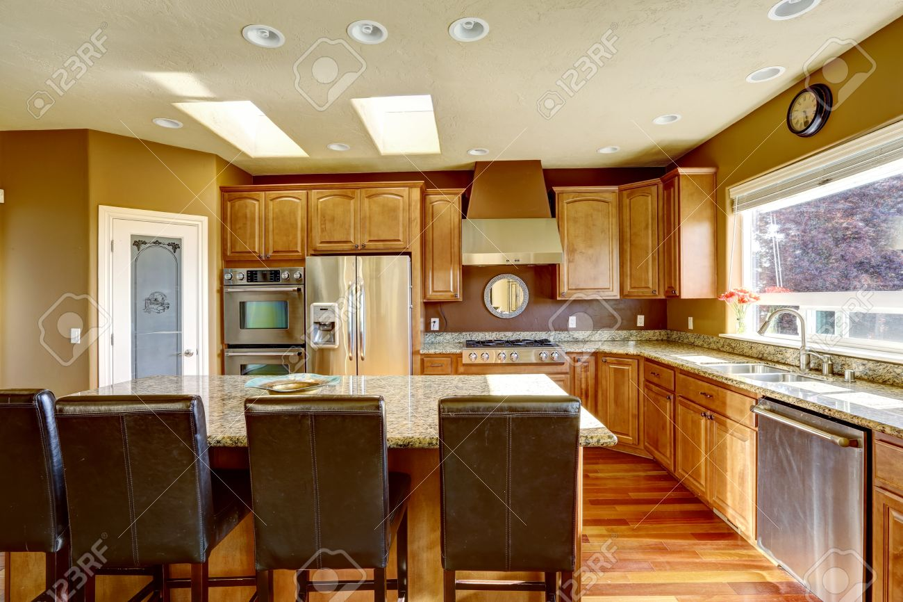 luxury kitchen with ss appliances and kitchen island with black