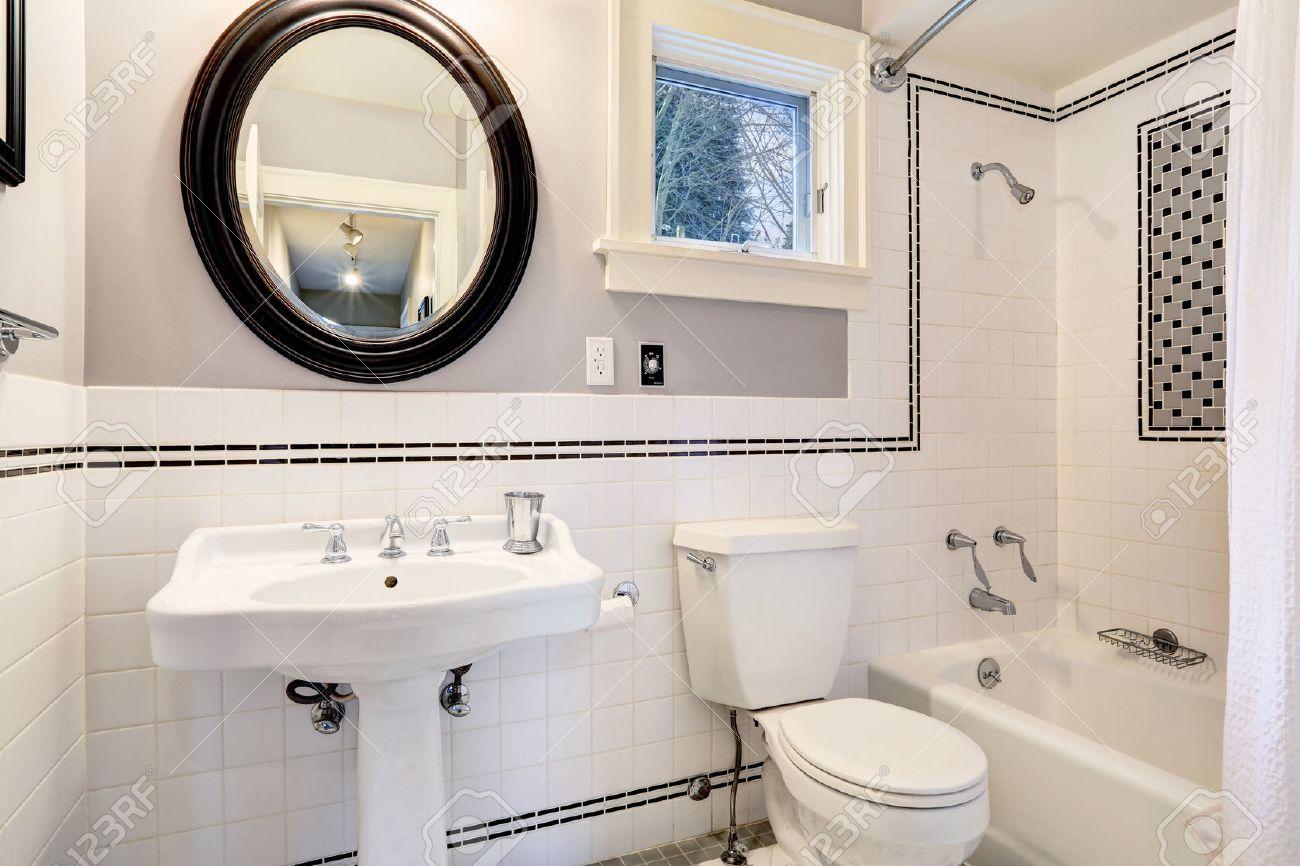 Bright Bathroom Interior With Tile Wall Trim, White Bath Tub ...