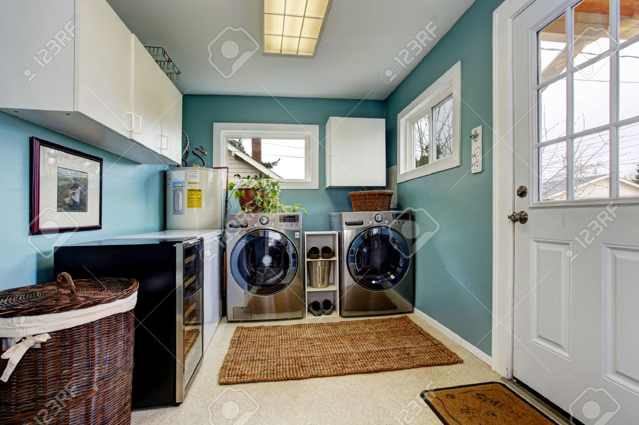 Light Blue Laundry Room With Modern Steel Appliances And White ...