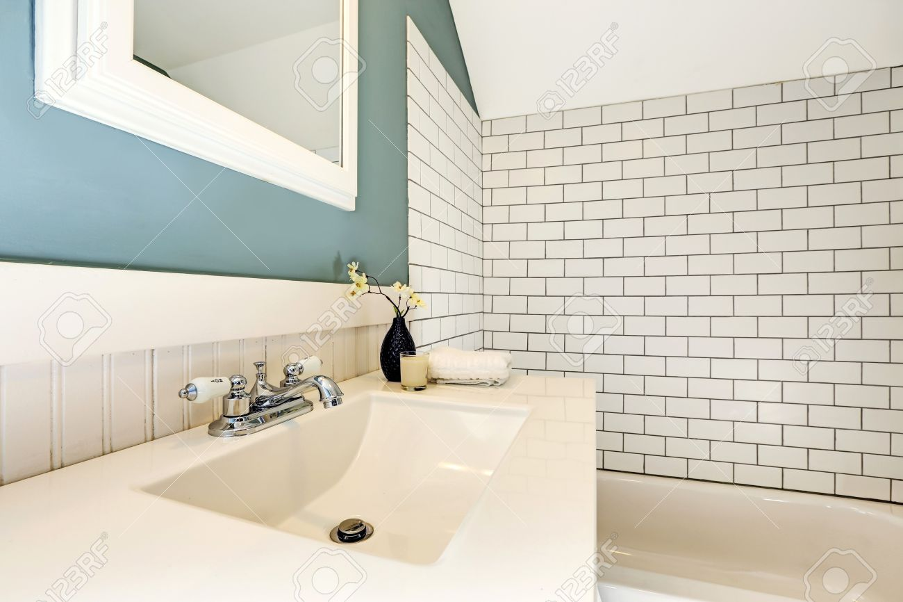 Bathroom Interior. View Of Bath Tub With White Tile Wall Trim ...