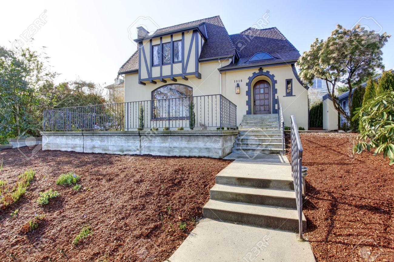 Beautiful Ivory English Tutor House With Stairs And Front Yard