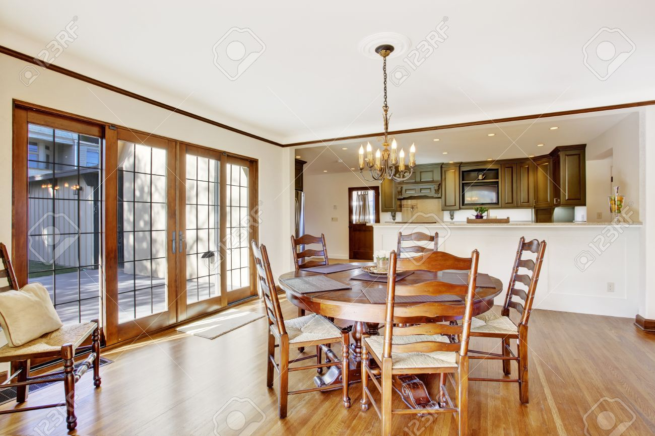 bright dining room in luxury house with french door to walkout bright dining room in luxury house with french door to walkout deck view of kitchen
