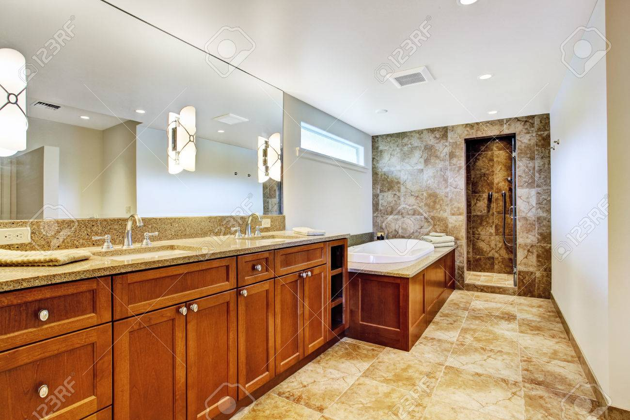 luxury bathroom interior with granite tile floor and open shower