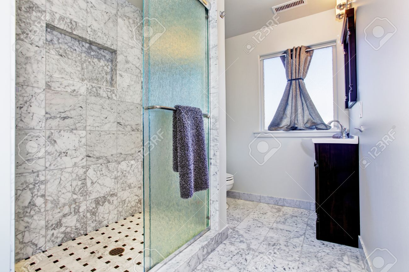Bathroom With Granite Tile Floor And Granite Tile Wall Trim In ...