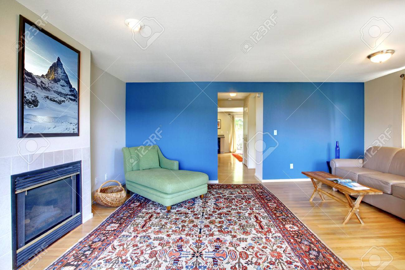 living room with bright blue and fireplace furnished with green