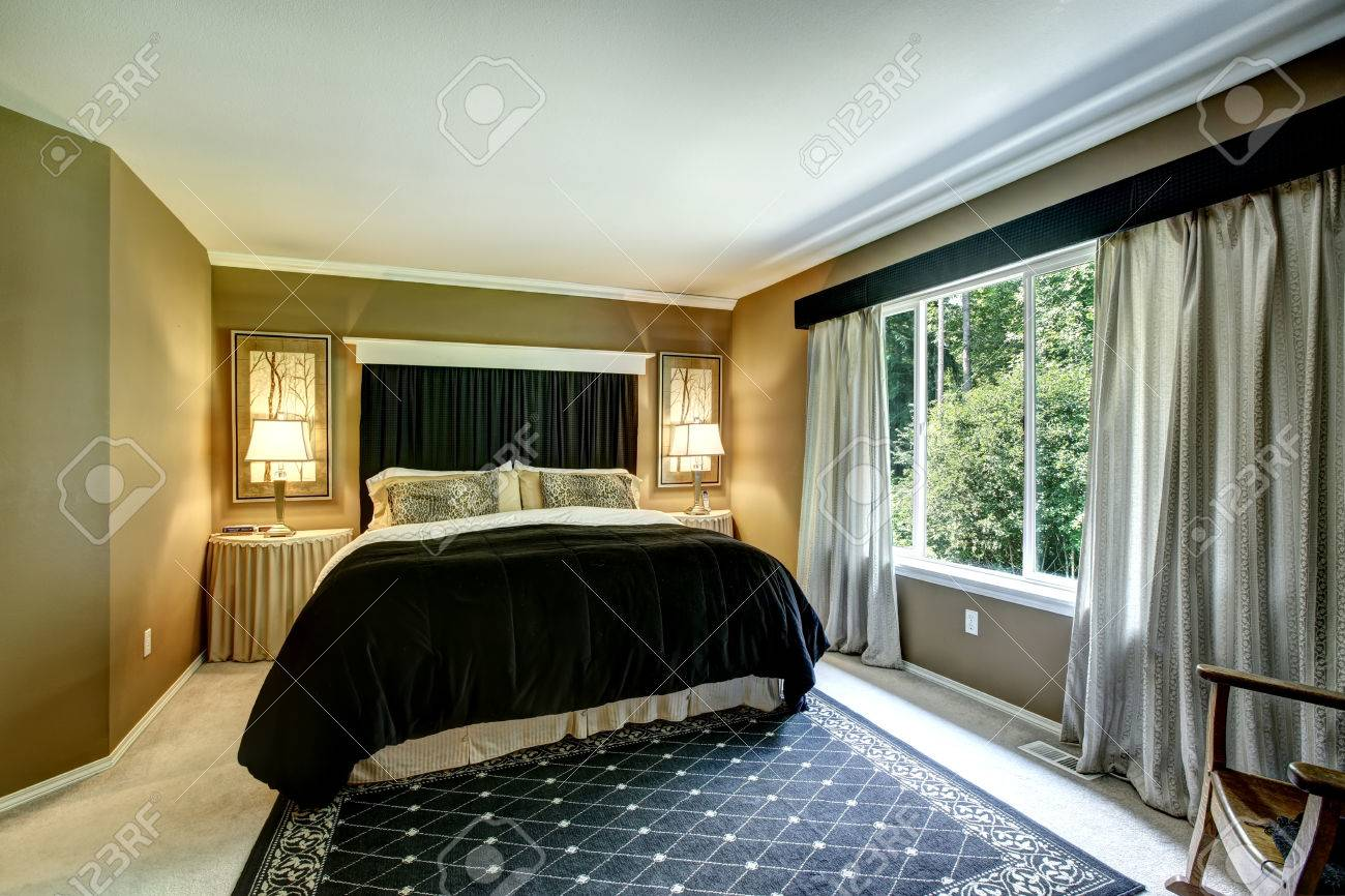 Elegant Bedroom With Light Grey Curtains Beautiful Bedding Cheetah Print Pillows Stock Photo