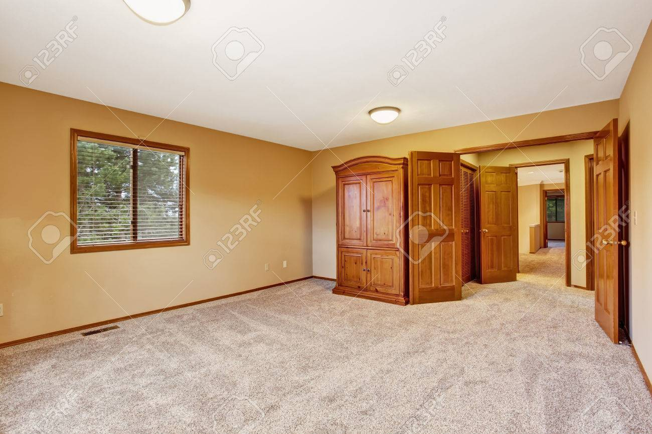 Empty Bedroom Interior In Soft Peach Color With Wardrobe Stock Photo    30374897
