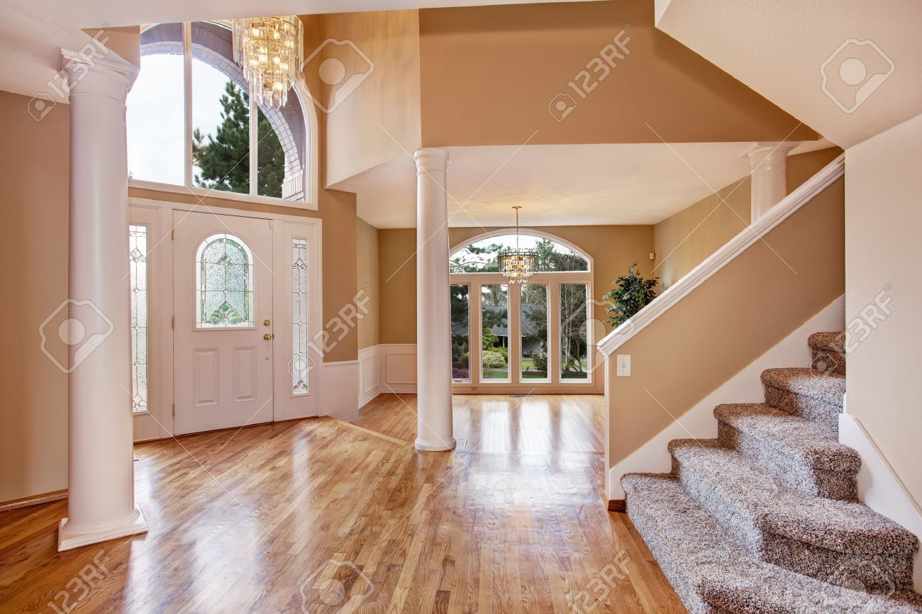 Beautiful entrance hall with high ceiling columns and arch window in luxury house stock