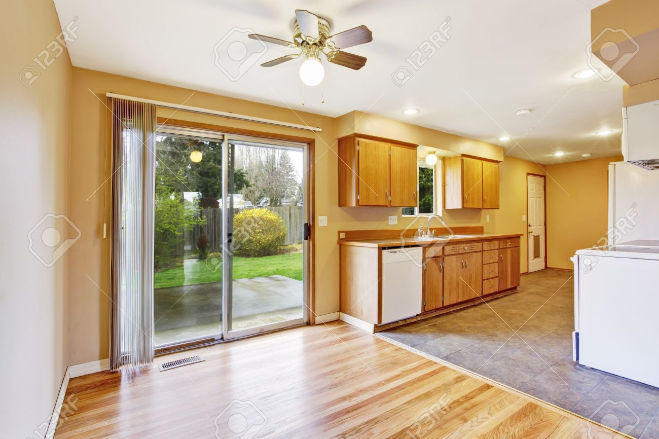 Kitchen Room With Empty Dining Area And Slide Door To Backyard