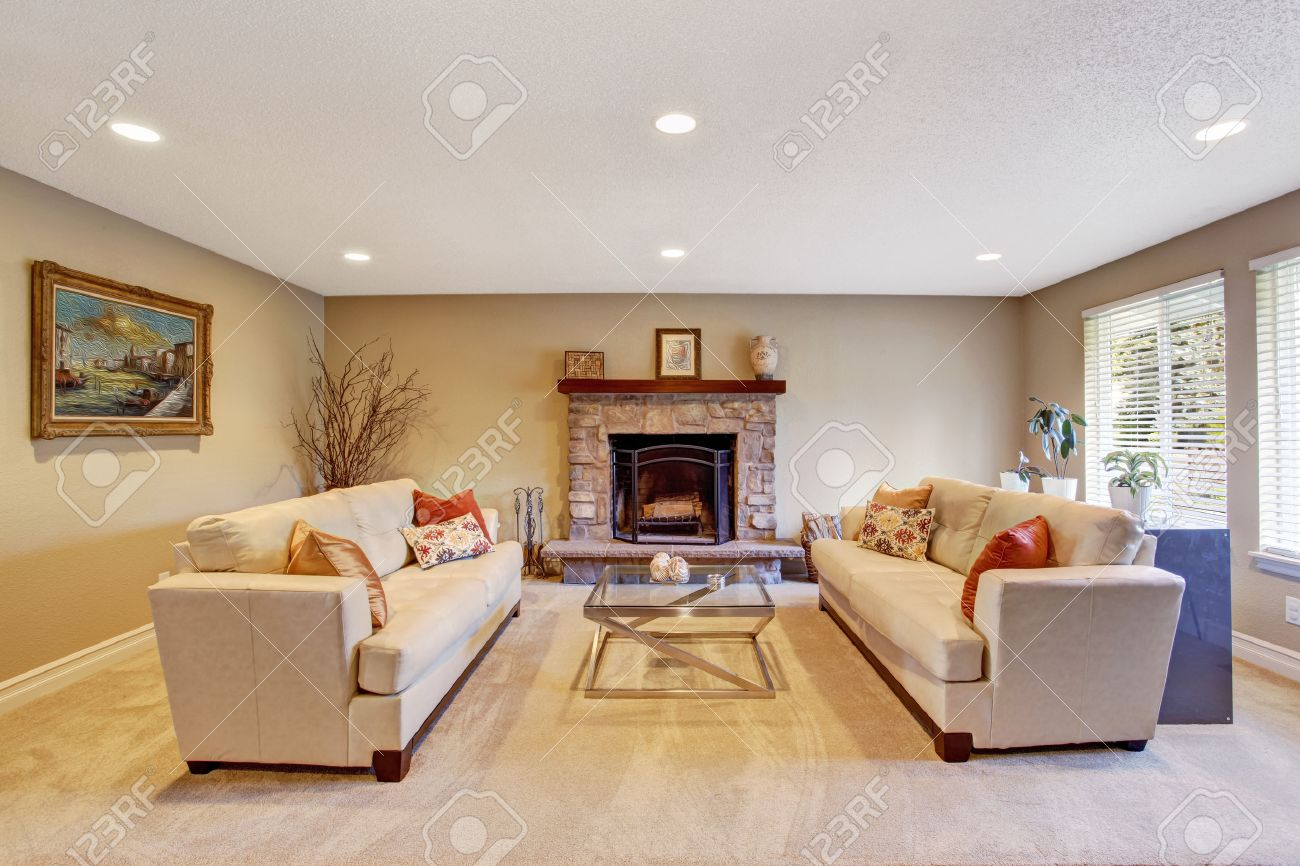 Light Tones Living Room With Fireplace, Two Couches And Glass Top Coffee  Table Stock Photo Part 73