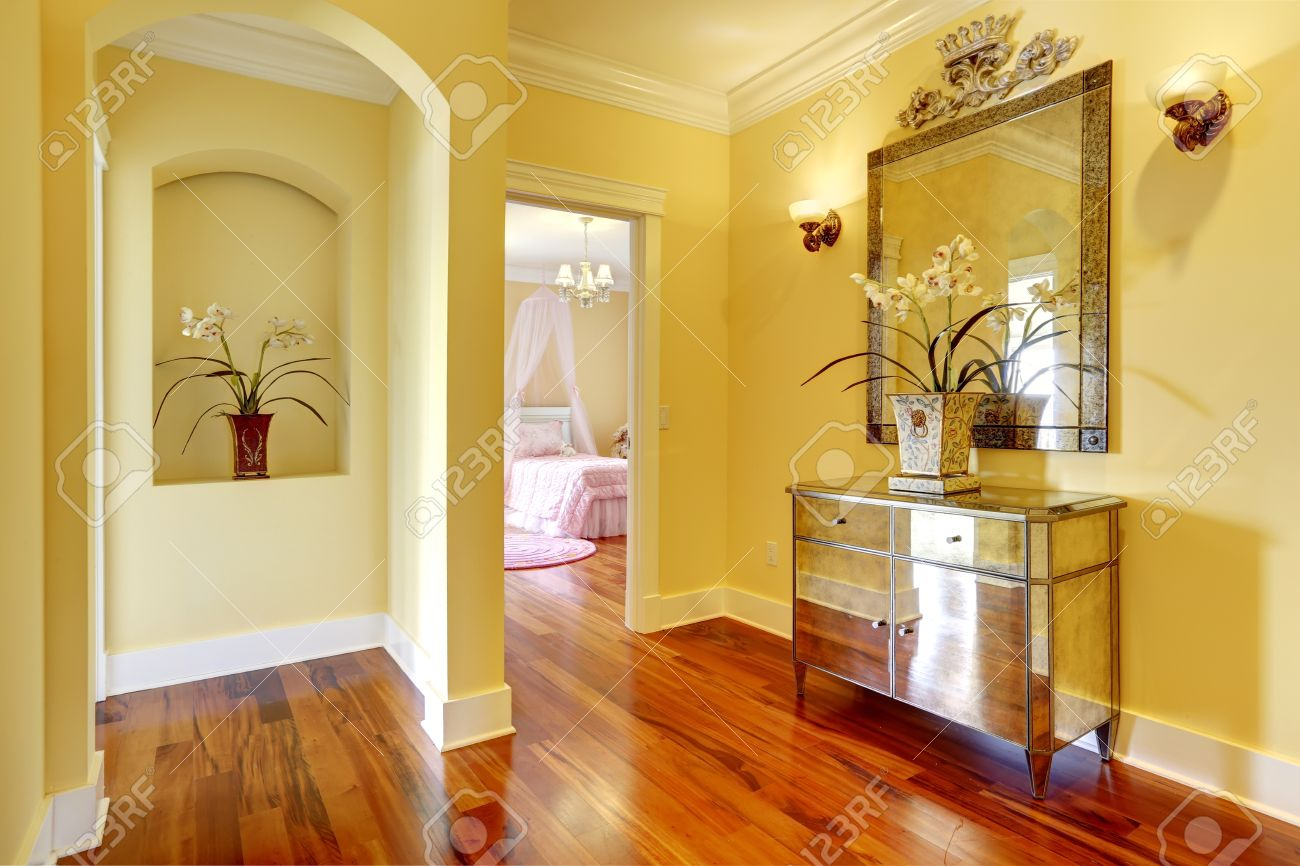 Bright Hallway With Shiny Cabinet, Arch Niche In Wall With ...