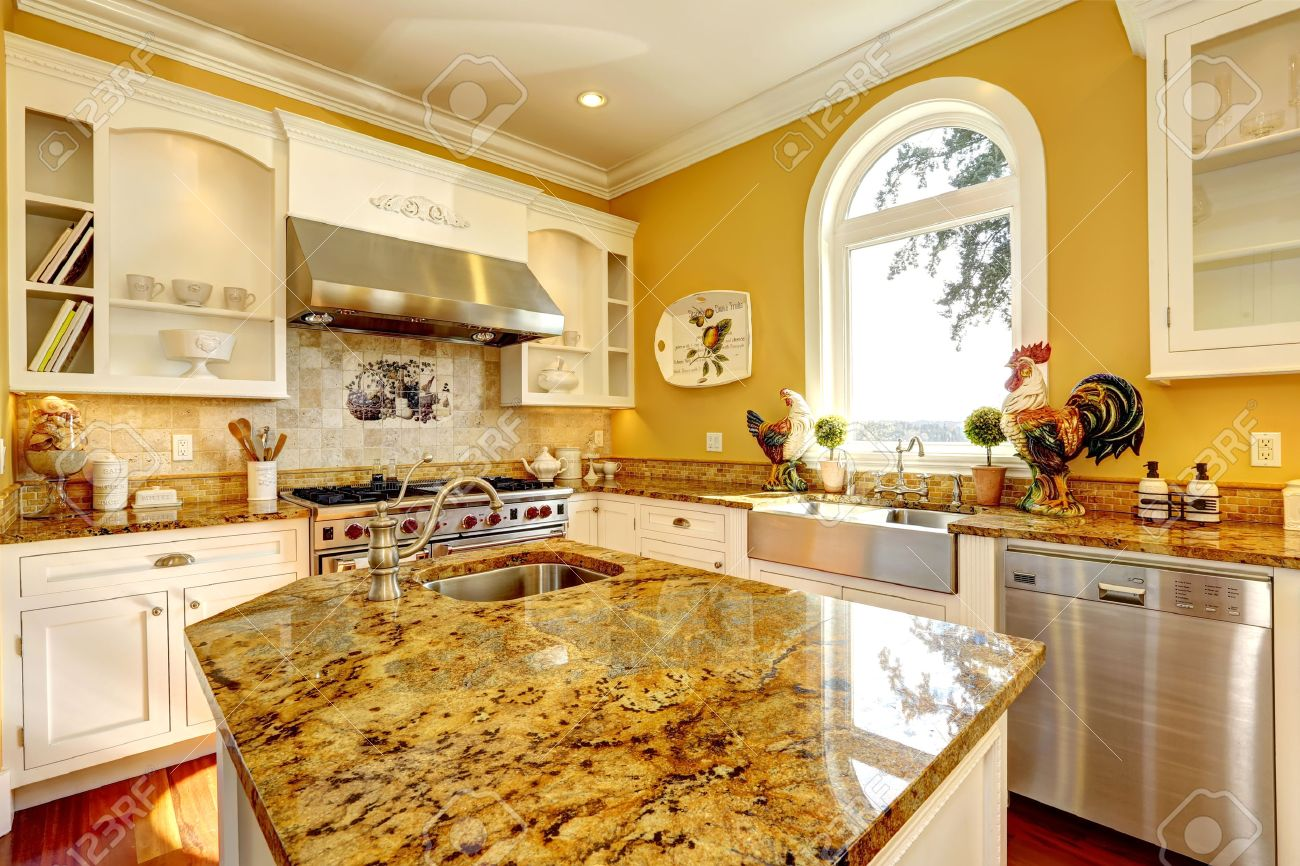 Bright Yellow Kitchen Interior In Luxury House With Granite Tops