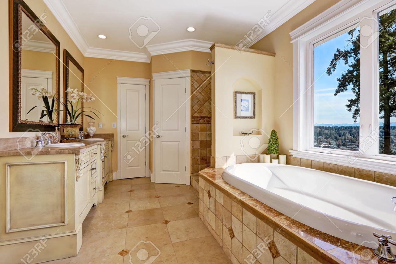 Soft tones bathroom interior with tile floor and tile wall trim soft tones bathroom interior with tile floor and tile wall trim antique vanity with mirror dailygadgetfo Choice Image