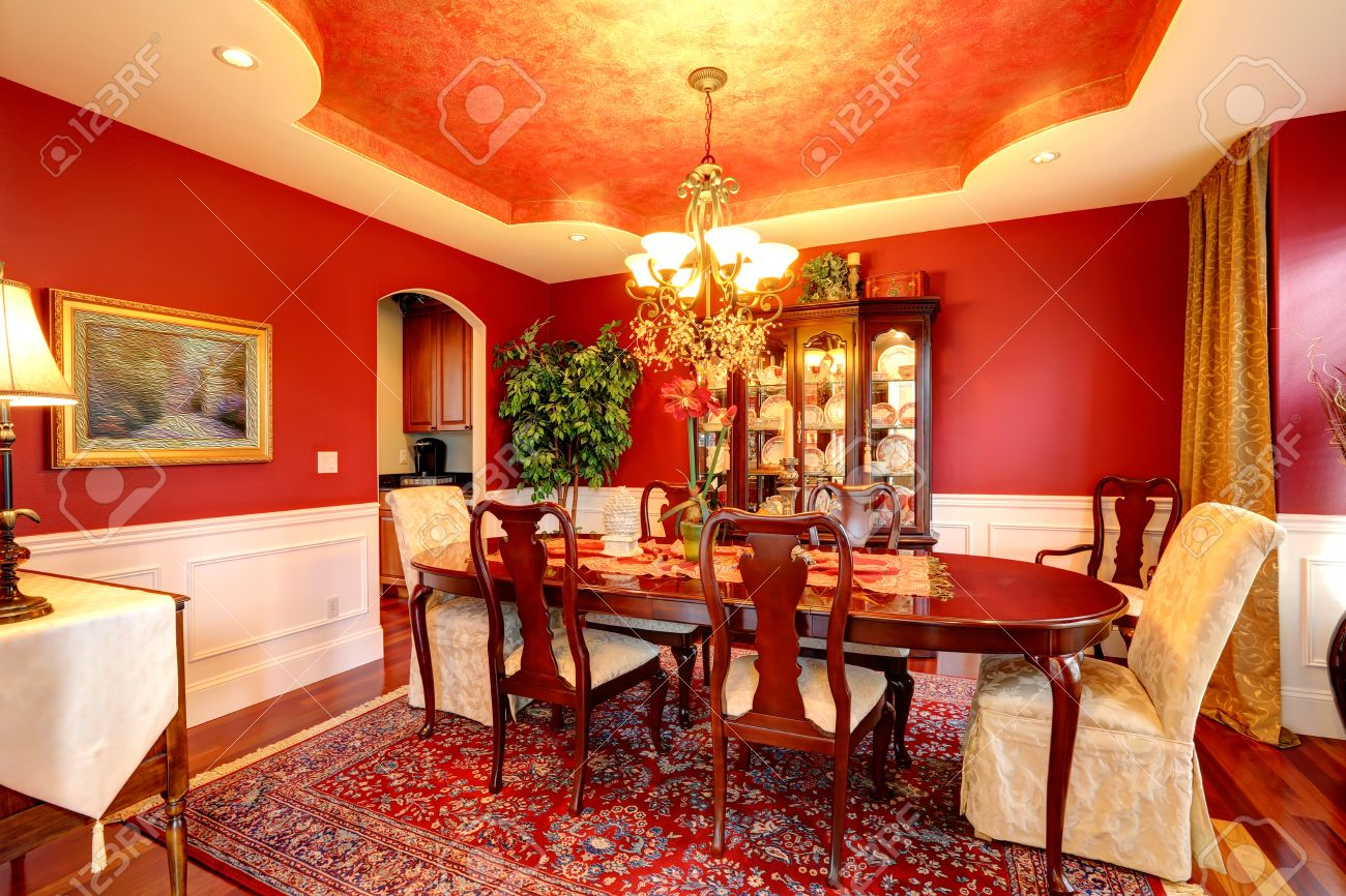 Luxury Dining Room With Rich Dining Table Bright Red Walls Blend Stock Photo Picture And Royalty Free Image Image 30761292